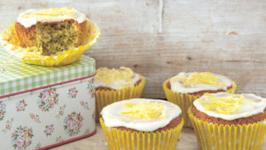 Iced cakes with lemon zest topping