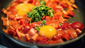 Vegetables and egg in a pan
