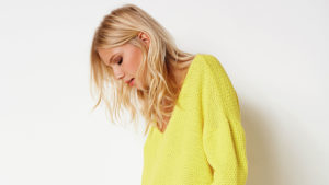 Model wearing yellow top from Laredoute