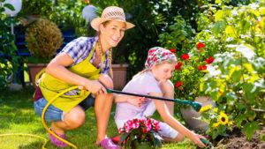 Mum and daughter watering garden Pic: Rex/Shutterstock