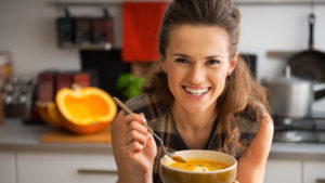 Lady eating homemade soup