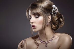 Lady with messy bun and jewelled clasp Pic: Istockphoto