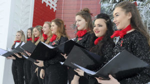 A choir outside the Ideal Home Show