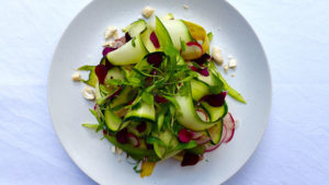 Raw vegetable salad with black garlic dressing