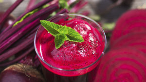 A glass of Pink Detox Blast smoothie with beetroot