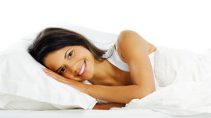 Lady comfortable in bed Pic: Rex/Shutterstock