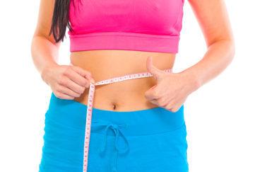 Lady measuring her waist Pic: Rex/Shutterstock