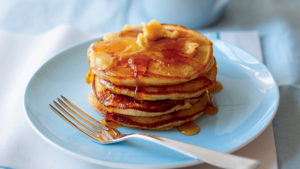 A stack of pancakes with maple butter
