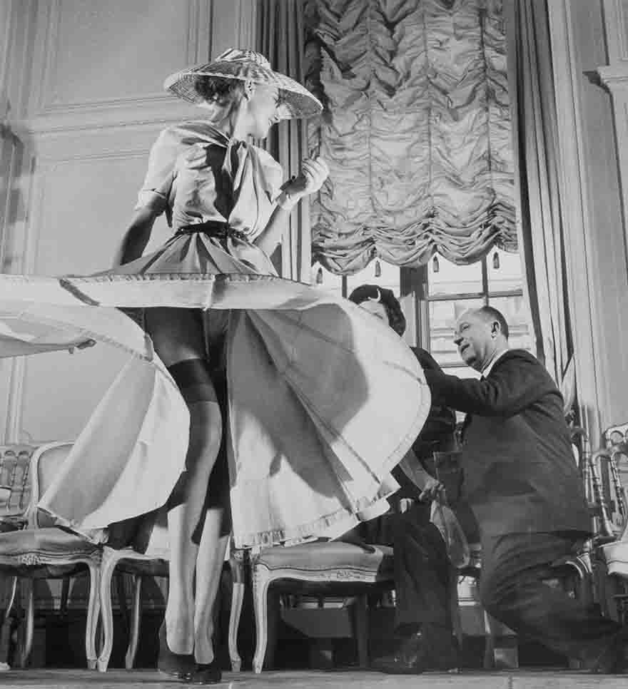 Stockings were highlighted for the first time when Christian Dior (right) exhibited his French collection
