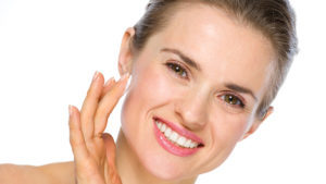 Lady applying face cream Pic: Dreamstime