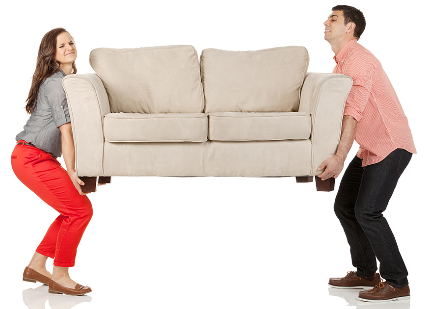 Young couple carrying sofa