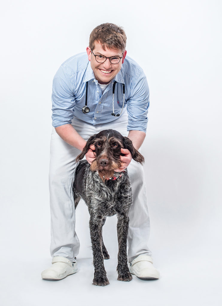 Man standing with dog