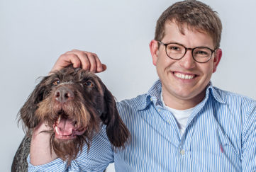 Man in glasses with dog