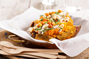Baked sweet potato stuffed with rice, chives and roasted chickpeas