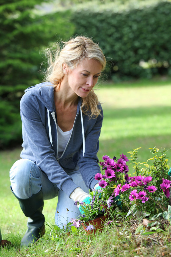 Woman kneeling to do gardening