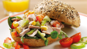 Seeded crusty roll filled with tuna and salad