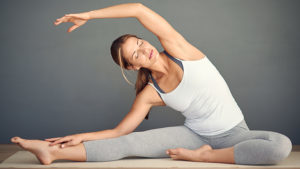 Shot of a young woman practising yoga
