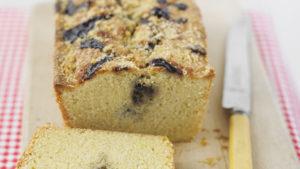 Lemon and blueberry swirl cake, loaf shaped, one slice cut