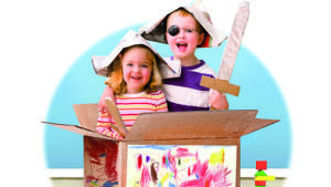 boy and girl playing in cardboard box