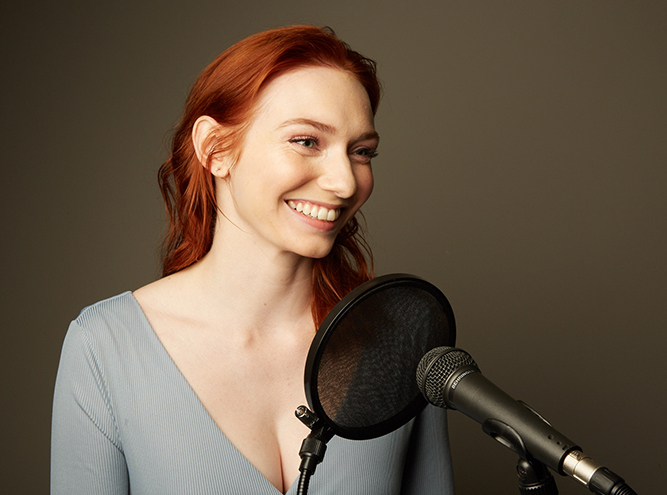 Eleanor Tomlinson reads into a microphone