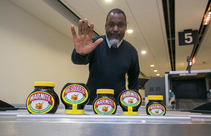 Man at airport security saying no to Marmite