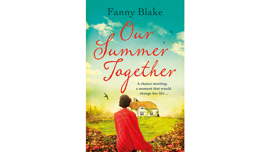 Our summer Together jacket woman in red looking at cottage
