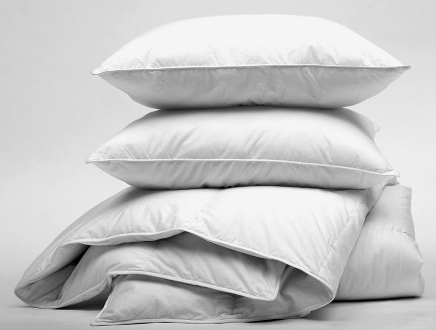 Pile of bedding - pillows and duvet