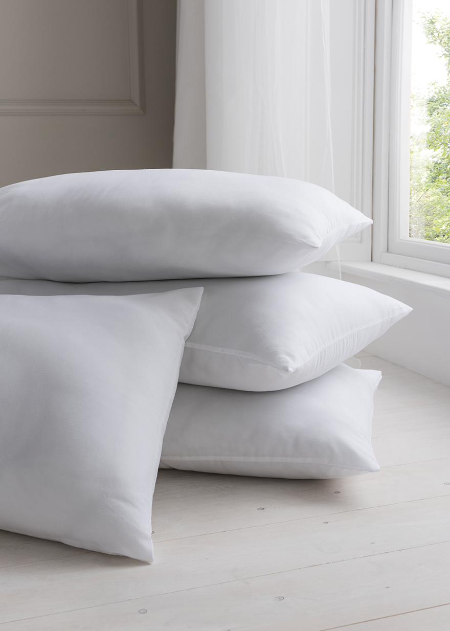 Four pillows in a stack