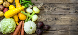 Fruit and veg on a wooden floor