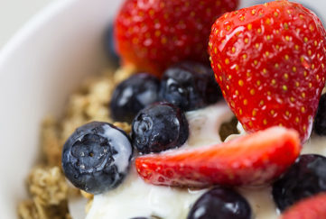 Strawberries and blueberries on cereal