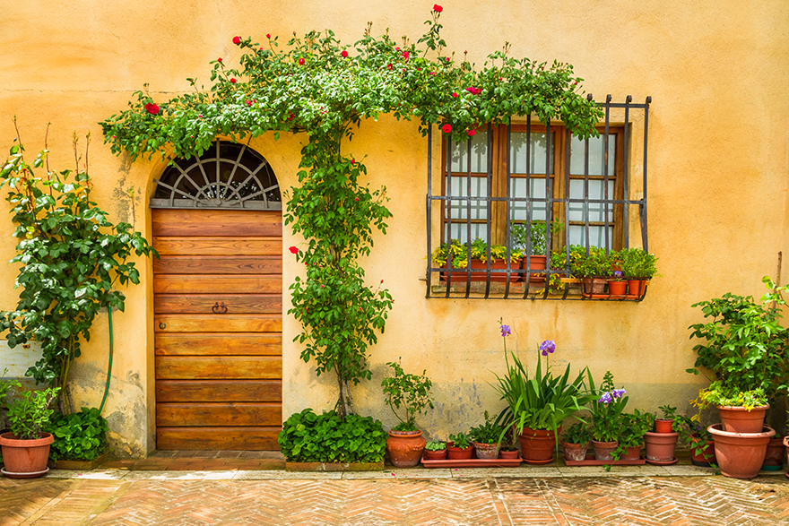 Beautiful porch decorated with flowers in italy.
