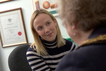 Optometrist Sarah Farrant talking to a patient