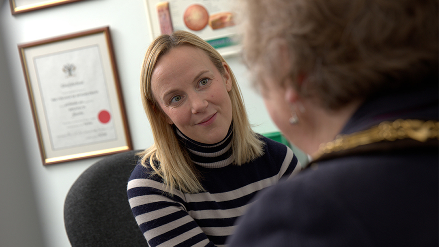 Optometrist Sarah Farrant talking to a patient