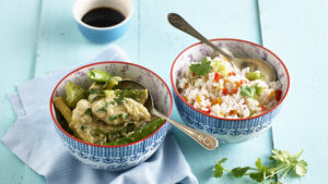 Thai green curry in a bowl with rice