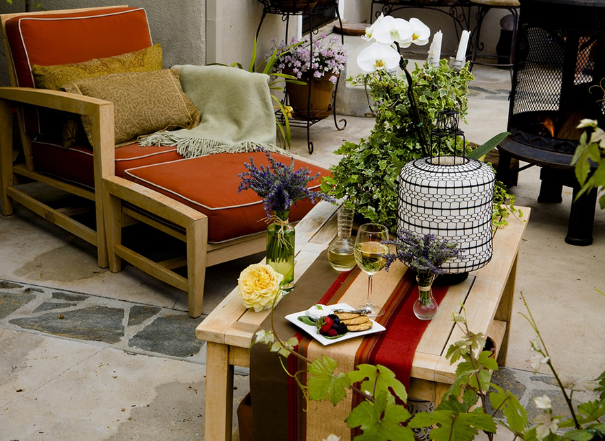 A patio with comfy chairs and table
