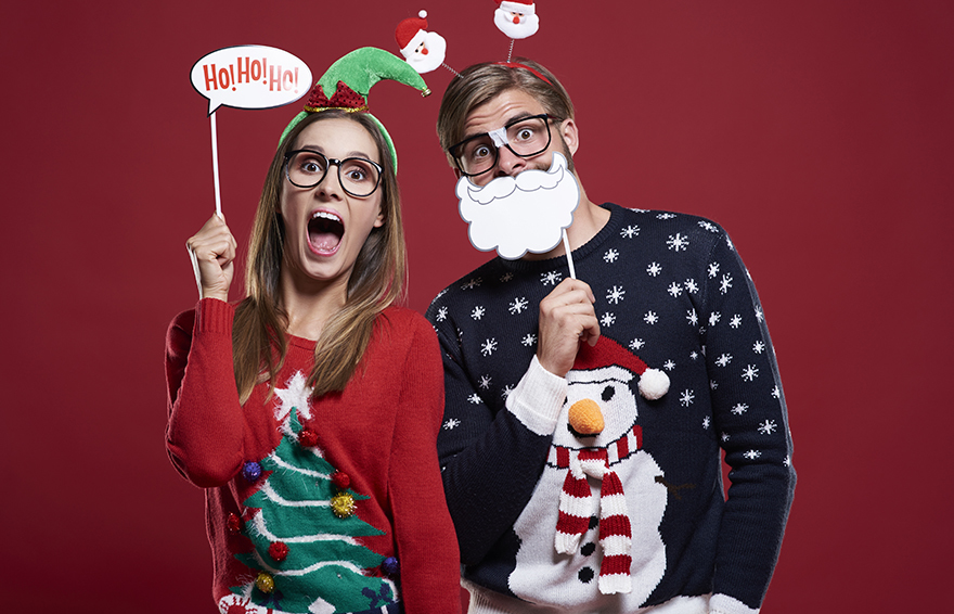 Couple with Christmas jumpers Pic: Istockphoto