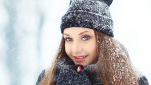Winter young woman portrait. Beauty Joyful Model Girl laughing and having fun in winter park. Beautiful young woman laughing outdoors. Enjoying nature, wintertime. Pic: Istockphoto