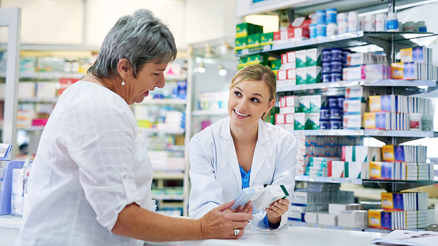 Shot of a young pharmacist assisting a customer