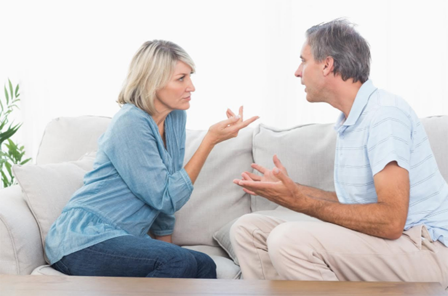 Couple arguing on settee