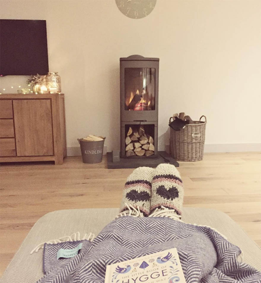 Feet with socks in front of fire