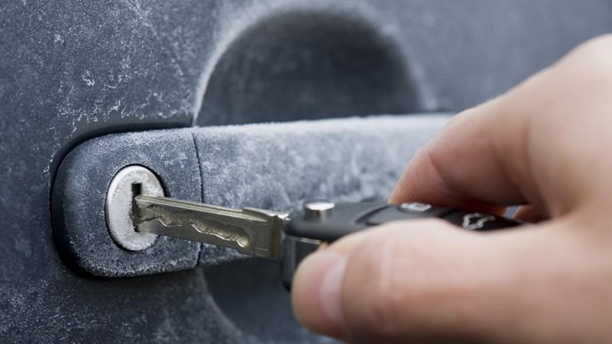 Car key going in frosty lock