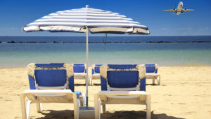 Blue sunloungers and umbrellas on beach