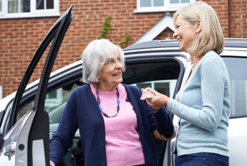 Lady helping a neighbour Pic: Shutterstock