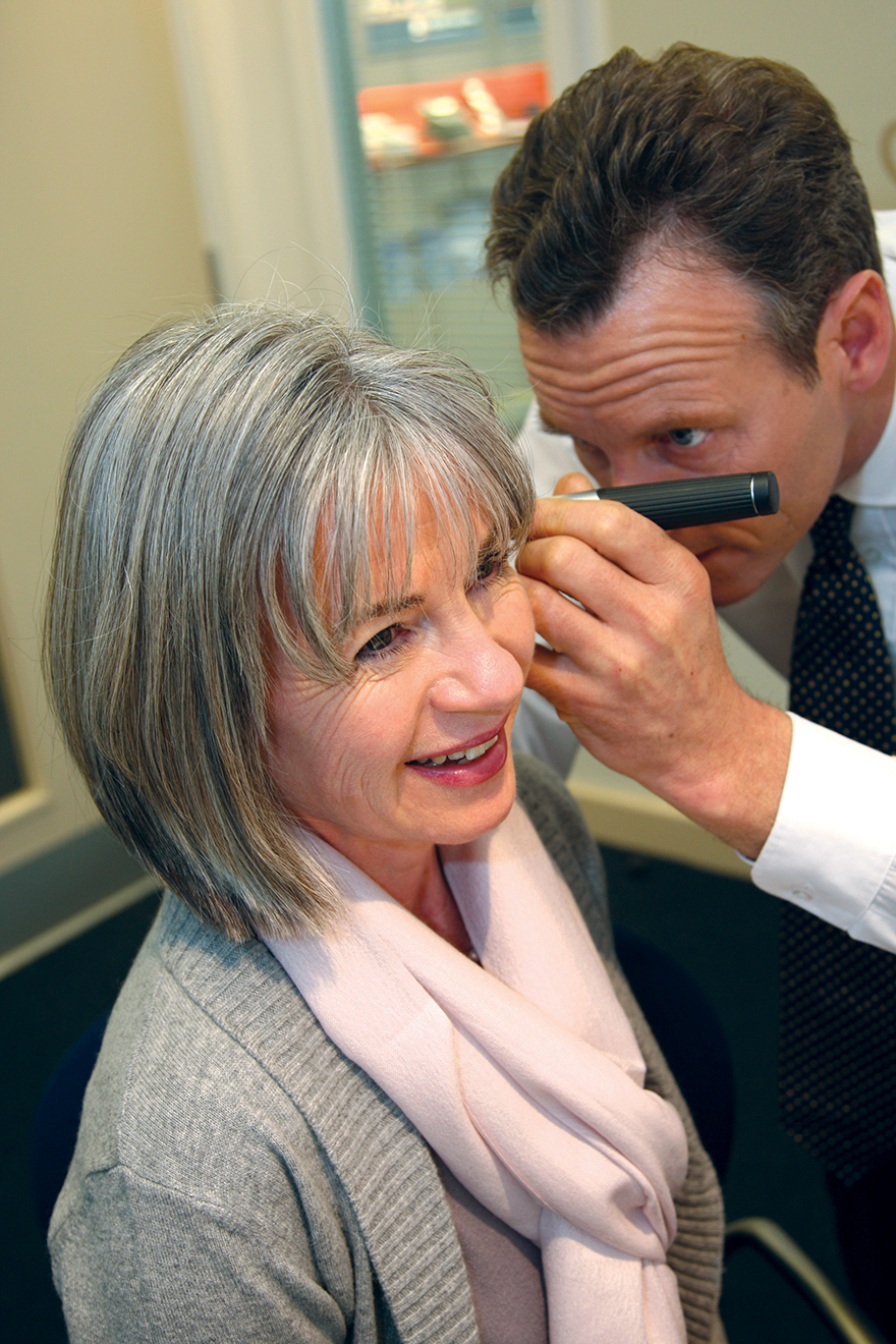 Woman having hearing test