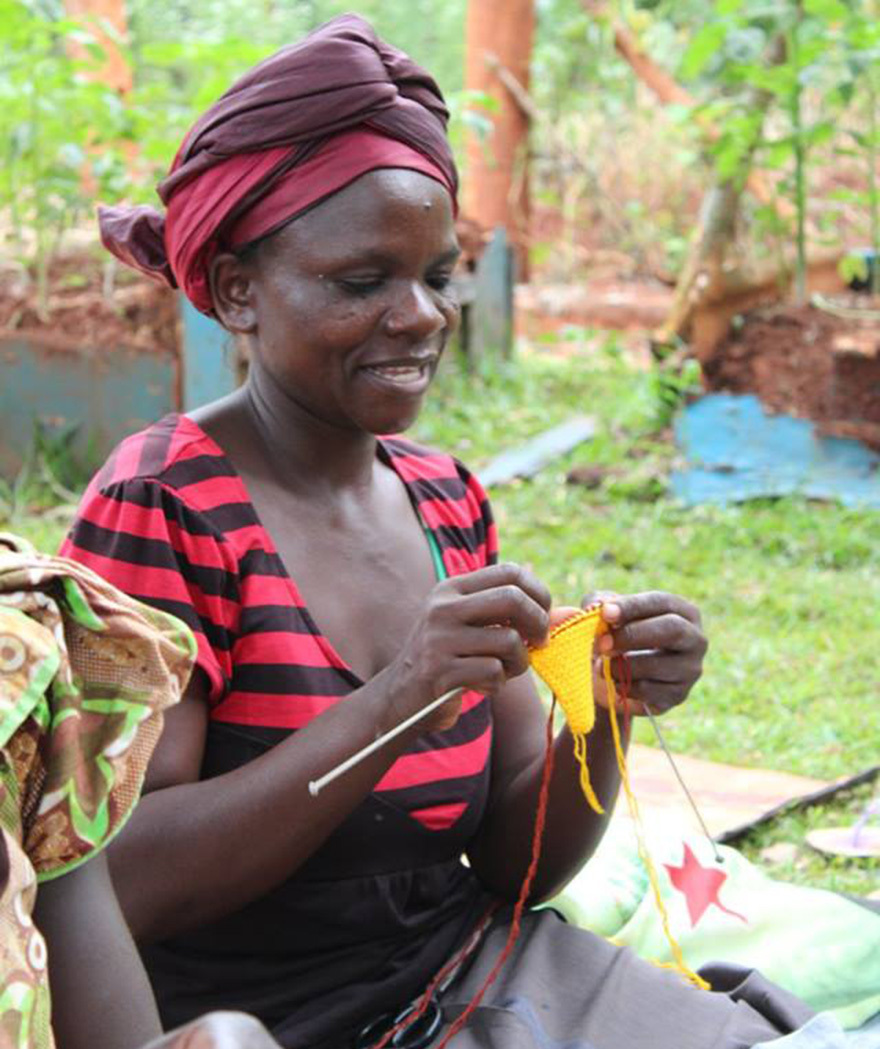 One lady in Uganda knitting for the appeal