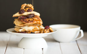 Stack of pancakes with apple on top