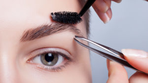 Lady tidying eyebrows Pic: Istockphoto
