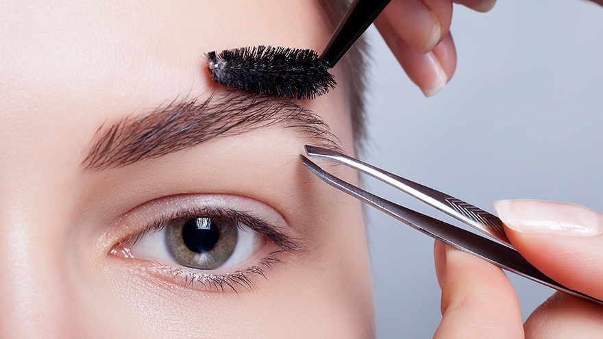 Lady tidying eyebrows Pic: Istockphoto