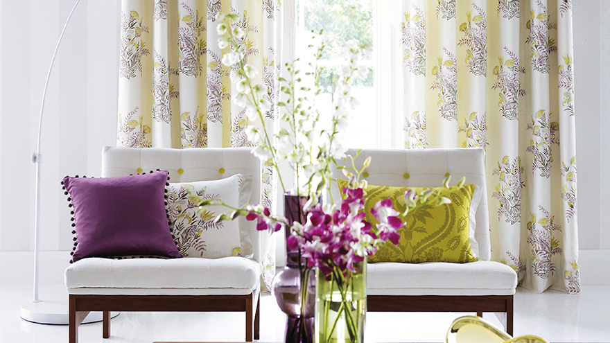 Living room with purple and green accessories Pic: Istockphoto