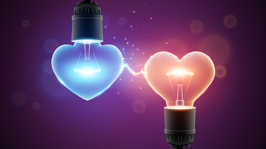 Two glowing lamps in heart shapes